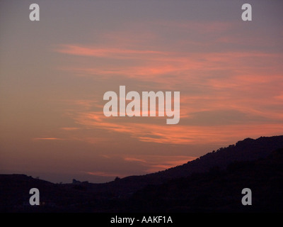 Sunset over the Sierra de Tejeda mountains in the Axarquía region of Southern Spain Europe Spanish sunsets dusk evening - Stock Image