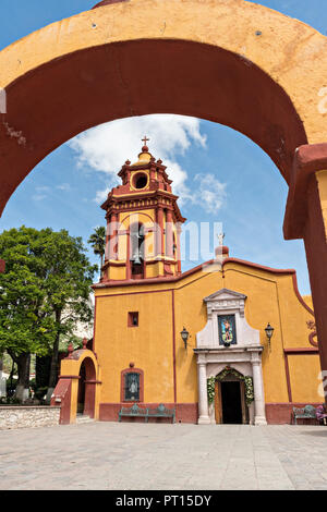 The Parroquia San Sebastian church in the beautiful colonial village of Bernal, Queretaro, Mexico. Bernal is a quaint colonial town known for the Pena de Bernal, a giant monolith which dominates the tiny village is the third highest on the planet. - Stock Image