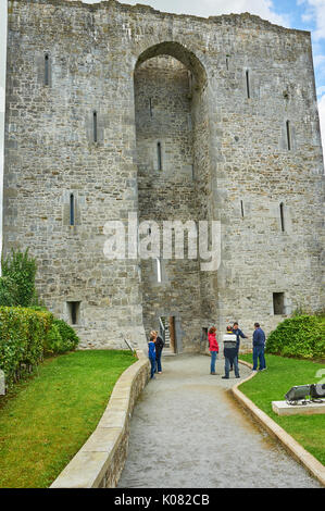 Tourists outside the ruins of Listowel Castle in County Kerry, Ireland - Stock Image