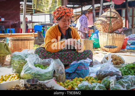 Balance sheet of a working day (Inle Lake, Shan state) - Stock Image