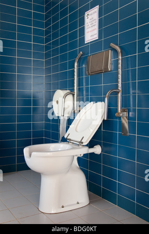 Public toilet with handicap supports - Stock Image