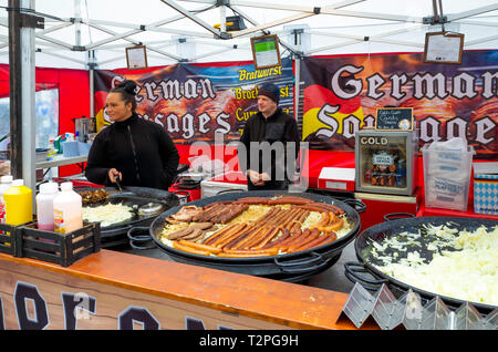 Stall selling  German food  with several varieties of sausage from a stall at Darlington Food market - Stock Image
