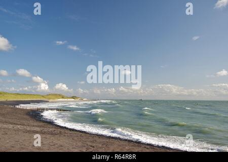 dyke,dunes,beach and north sea with seagoing vessels at westkapelle,walcheren,zeeland,southern netherlands - Stock Image