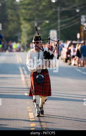 A lone bagpiper leading the 4th of July parade in Speculator, NY USA on June 30, 2018. - Stock Image