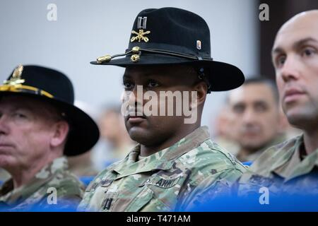 U.S. Army Cpt. Darell Baldwin, troop commander for the California National Guard's Bravo Troop, 1st Squadron, 18th Cavalry Regiment (1-18 CAV), attends his unit's transfer of authority ceremony at the Joint Training Center in Jordan, March 14, 2019. The 1-18 CAV relinquished authority of their mission to New Jersey National Guard's 1st Squadron, 102nd Cavalry, who will spend the next nine months on rotation in Jordan where they will train with JAF Border Guard Forces as part of the Jordan Operational Engagement Program. (Army National Guard - Stock Image