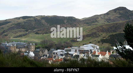A view of Arthurs seat with the Scottish Parliament building and the Palace of Holyrood as seen from Calton Hill - Stock Image