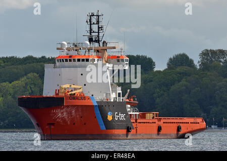 Offshore Supply Ship Omalius at anchor on the Kiel Fjord - Stock Image