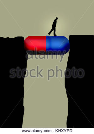 Man walking across large pill capsule bridging the gap between cliffs - Stock Image