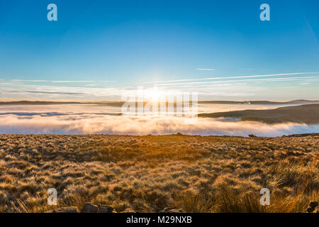 Fantastic view on a foggy and sunny day at the District National Park. The mountain peaks are visible through the - Stock Image