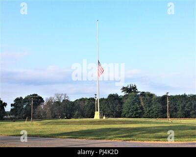The United States flag flies at half-staff Aug. 28, 2018, at Fort McCoy, Wis., in honor of U.S. Senator John S. McCain III who died Aug. 25. McCain was an American politician and naval military officer who served as a United States Senator from Arizona from 1987 until his death. He previously served two terms in the United States House of Representatives and was the Republican nominee for President of the United States in the 2008 election. According to johnmccain.com, McCain was the son and grandson of distinguished Navy admirals and he graduated from the Naval Academy in 1958. He served as a - Stock Image