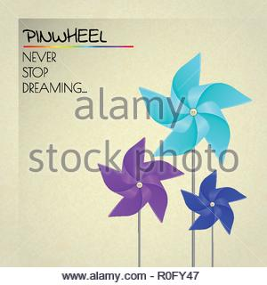 Colorful violet, blue and dark blue pinwheels on the beige background - Stock Image