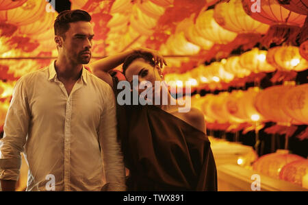 Attractive and relaxed couple enjoying the asian festival - Stock Image