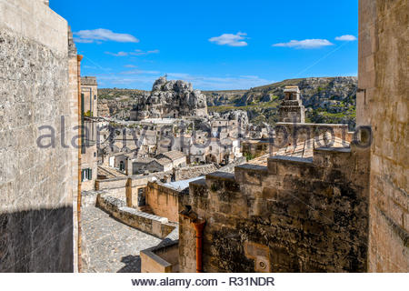 The walls, caves and dwellings surround the ancient Madonna de Idris rock church and the Sassi of Matera, Italy, in the Basilicata region. - Stock Image