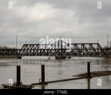Panoramic view of the historic metal truss swing bridge on I Street in Sacramento, California,  connecting Yolo County with Sacramento County, on a pa - Stock Image