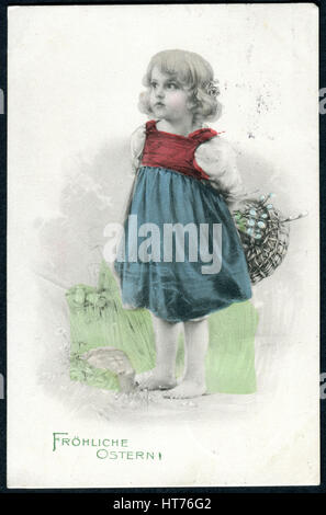 A greeting postcard printed in Austria, shows a little girl with willow branches. The inscription in German: Happy - Stock Image