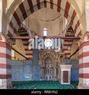 Blue ceramic tiles, Engraved Mihrab (niche) and decorated marble Minbar (Platform), Mosque of Aqsunqur (Blue Mosque), Cairo, Egypt - Stock Image