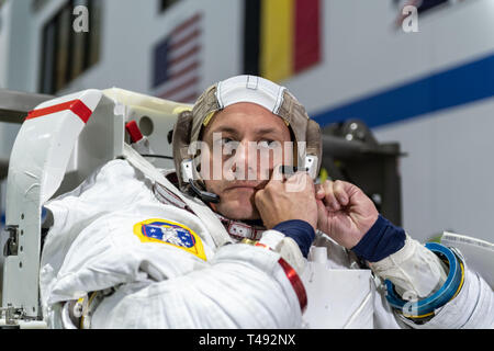 Boeing Commercial Crew Program astronaut Josh Cassada in his spacesuit before entering the pool at the Neutral Buoyancy Laboratory for ISS EVA training in preparation for future spacewalks while onboard the International Space Station at the Johnson Space Center November 2, 2018 in Houston, Texas. - Stock Image