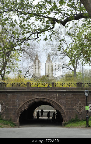 East side of the Trefoil Arch, with the west side's single curved arch visible in silhouette. Central Park, - Stock Image