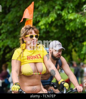 Brighton, UK. 9th June, 2019. Hundreds of cyclists take part in the Brighton leg of the World Naked Bike Ride celebrating bikes, bodies and low-impact living protesting against fossil-fueled climate change . This year 's ride is in conjunction with the Extinction Rebellion environmental group, riding under the banner We Are Nature!, focusing on the climate crisis . Credit: Simon Dack/Alamy Live News - Stock Image