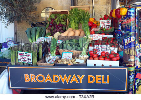 A selection of vegetables displayed outside the Broadway Deli, in the Worcestershire village of Broadway, UK. - Stock Image