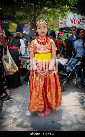 Beautiful young Nepalese girl in a colorful costume prior to performances celebrating the anniversary of the first successful climb of Mount Everest. - Stock Image