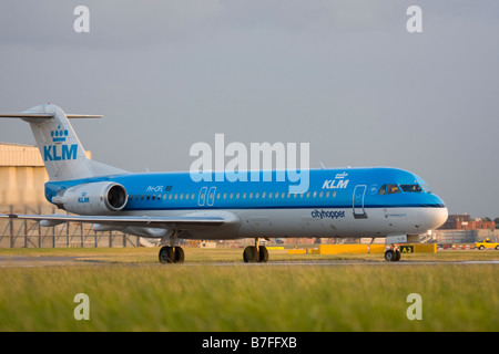 KLM Cityhopper Fokker 100 (F-28-0100) at London Heathrow airport. - Stock Image