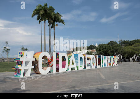 View of Praça Mauá with the #CIDADEOLIMPICA sign prominent in front of palm trees. Olympic Games, Rio - Stock Image