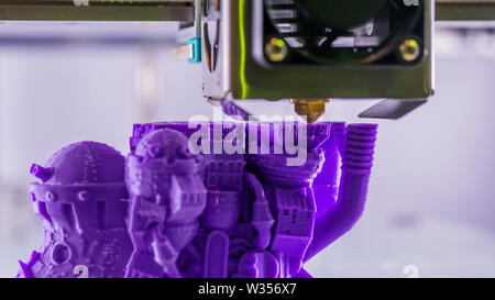 Three dimensional printing machine prints physical 3D model - Stock Image