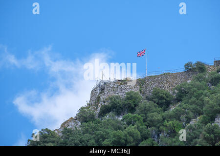 GIBRALTAR, SPAIN: 12-MAY 2017: Union Jack flag at the top of the Rock of Gibraltar in May, 2017. - Stock Image