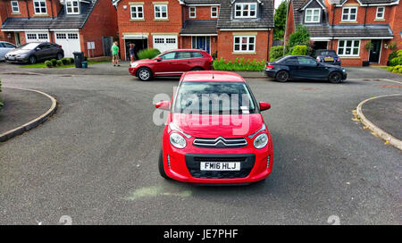 Ashbourne, UK. 22nd Jun, 2017. A car inconsiderately parked in the middle of the road all day by it's owner obstructing - Stock Image