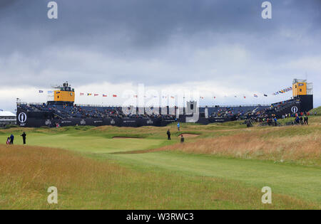 Portrush, Country Antrim, Northern Ireland. 17th July, 2019. The 148th Open Golf Championship, Royal Portrush Golf Club, Practice day; a view of the 18th hole and grandstands surrounding the green Credit: Action Plus Sports Images/Alamy Live News - Stock Image