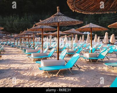 Thassos Marble Beach Vathy chairs and umbrellas - Stock Image