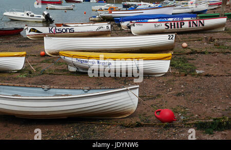 Rowing Boats Beached on The Back Beach, Teignmouth, South Devon, England, UK - Stock Image