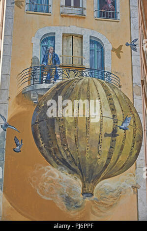 The world's first balloon flight by the Mongolfier brothers is depicted as artwork on buildings in Annonay, Ardeche department, France. - Stock Image
