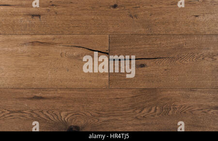 Top view photo of vintage rustic smoked Australian oak wood floor boards with rough texture, brushed and handscraped - Stock Image