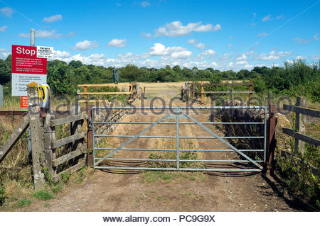 Railway level crossing - user operated (after phoning signalman) crossing for agricultural workers to access farm land, near Chetnole in Dorset, UK. - Stock Image