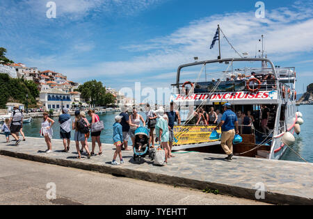 Tourists disembarking at Skopelos Harbour, Northern Sporades Greece. - Stock Image
