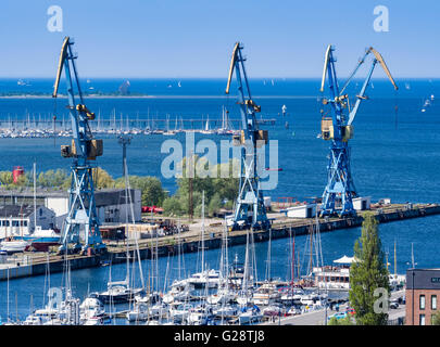 Cranes at the harbor, seen from platform of St. Georgen church, Wismar, Germany. - Stock Image
