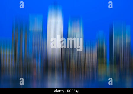canary wharf skyline shot from across the river thames with artistic blur effect - Stock Image