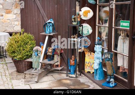 Wood carved art sculptures in shop exterior in Kazimierz Dolny, Poland, Europe, bohemian tourist travel destination, - Stock Image