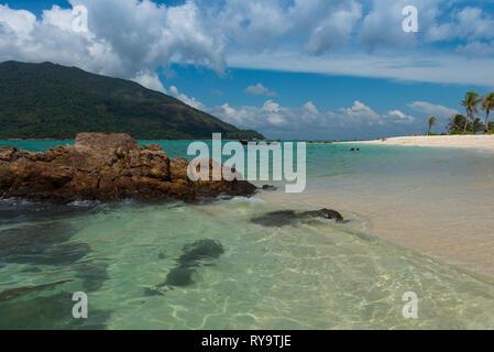 Rocks in the sea on Koh Lipe beach, Thailand - Stock Image