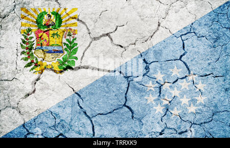 Sucre State flag, state of Venezuela, on dry earth ground texture background - Stock Image