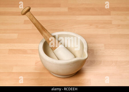 A pestle and mortar on a kitchen worktop - Stock Image