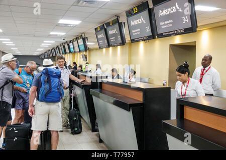 Cartagena Colombia Aeropuerto Internacional Rafael Nunez International Airport CTG terminal Hispanic resident residents man woman departing luggage Av - Stock Image