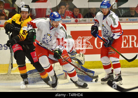 Karlovy Vary, Czech Republic. 18th Apr, 2019. (L-R) Lean Bergmann of Germany, Radim Zohorna and Jan Stencel of Czech Republic in action during the Euro Hockey Challenge match Czech Republic vs Germany in Karlovy Vary, Czech Republic, April 18, 2019. Credit: Slavomir Kubes/CTK Photo/Alamy Live News - Stock Image