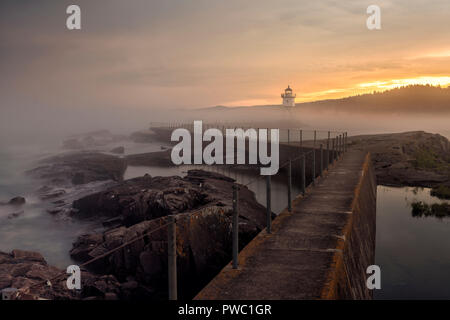 Grand Marais lighthouse with a summer storm passing over Lake Superior. - Stock Image