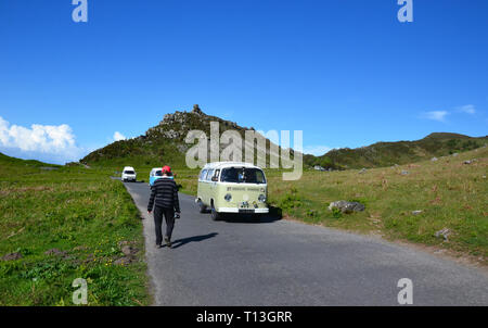 VW Campervan travelling through the Valley of the Rocks, near Lynton and Lynmouth, Devon, UK - Stock Image