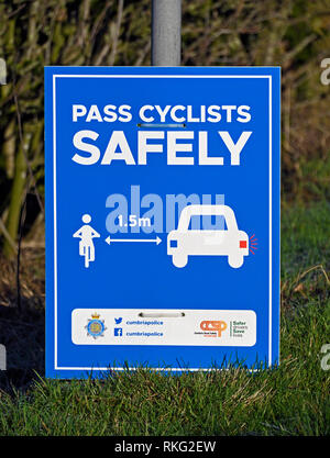 Cumbria Police road safety notice. 'PASS CYCLISTS SAFELY'. Hayclose Lane, Kendal, Cumbria, England, United Kingdom, Europe. - Stock Image