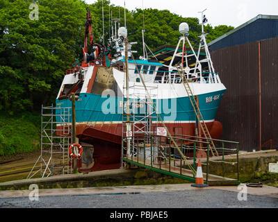 Trawler BH456 AQUARIUS II built in Norway in 1980, seen here in dock for overhaul in Eyemouth Berwickshire Scotland. - Stock Image