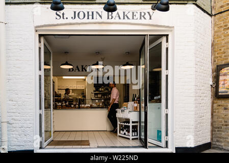 London, UK - May 15, 2019: Hipster bakery in Neals Yard, a small alley in Covent Garden area - Stock Image